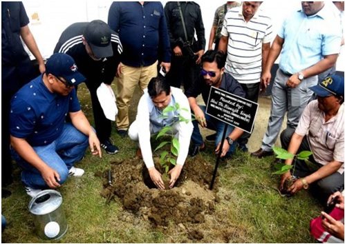 Thongam Biswajit Singh plant a tree sapling inside the premise  of Manipur Trade & Expo centre